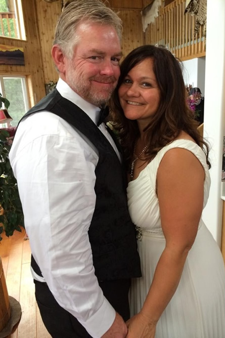 Maria and Tim on their wedding day – July 13, 2014, standing in the main house living room.